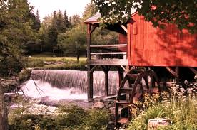 Mill wheel with spillway water, Weston, VT